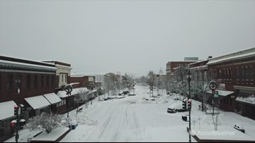 Drone footage shows town covered in snow