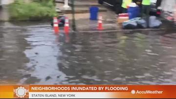 Neighborhoods inundated by heavy street flooding