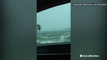 Car passes through extreme flooding