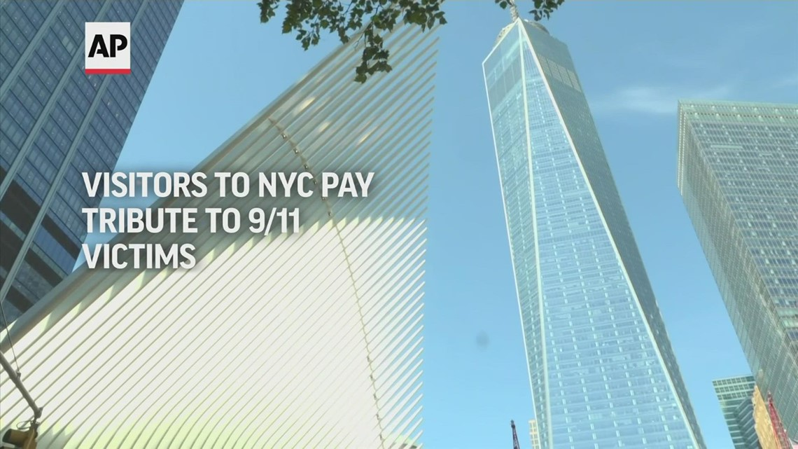 Visitors to NYC pay tribute to 9/11 victims