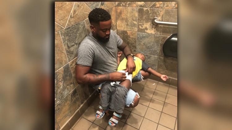 Donte Palmer squat diaper restroom