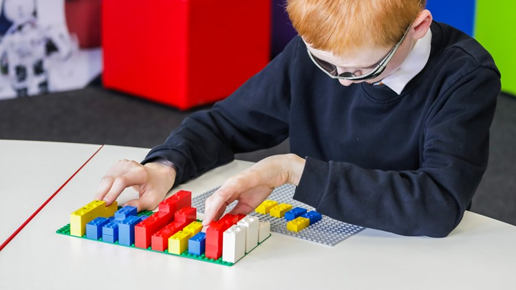 LEGO Braille Bricks child playing with toys