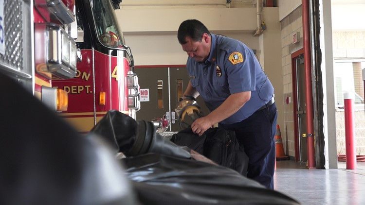 Mission Fire Deputy Chief Joel Dominguez readies his driving gear