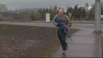 National Guard soldier exercises in Forest Grove with 55-lb pack and fake rifle