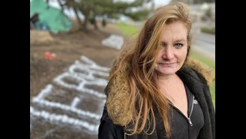 Homeless campers create holiday message along I-205