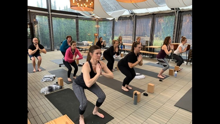 Dobbes employees in their weekly yoga class