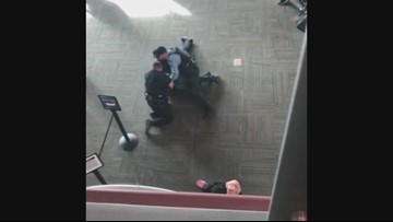 Armed man arrested at Medford airport