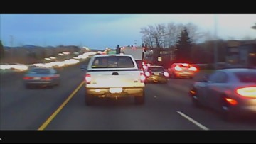 Video shows officer chase driver speeding on Highway 26 shoulder; suspect reportedly drags officer while fleeing arrest