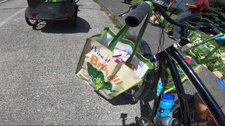 Volunteers delivering food by bike to Portlanders in need
