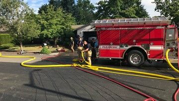 Construction workers rescue woman, 2 children from Gresham house fire