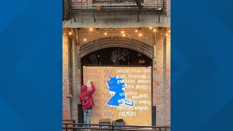 mural outside River Pig Saloon