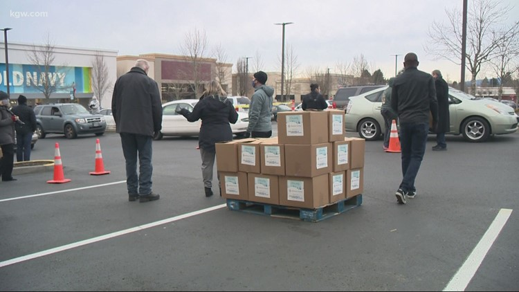 Hundreds of struggling families take home food boxes with help of surprise donation