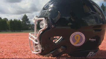 High School Football teams support Childhood Cancer Month
