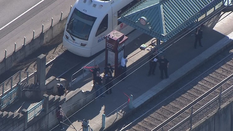 Police respond to a stabbing at the Hollywood Transit Center in Northeast Portland