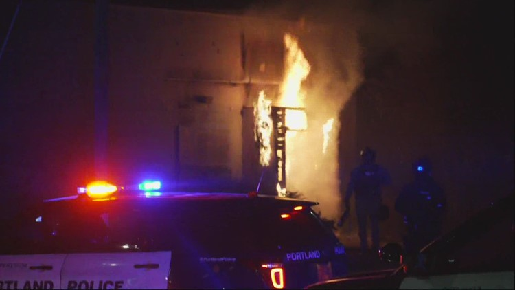 Police declare riot after person sets fire to door of Portland Police Association building