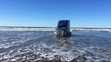 Beached big rig gets caught by tide on Oregon Coast