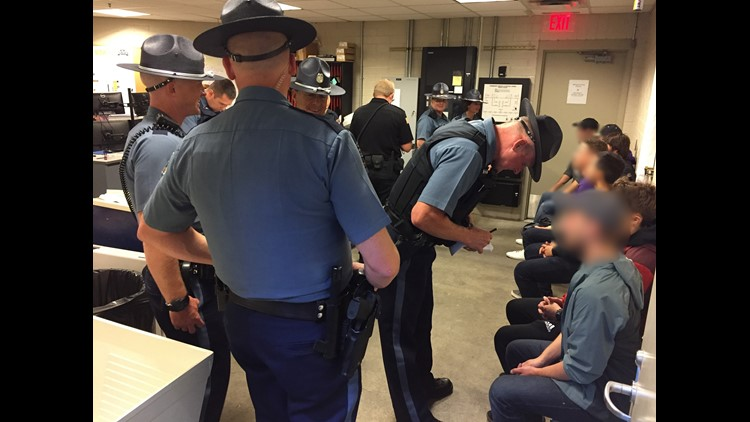 """Sgt. Proulx talks with fans in the """"exclusion room"""" at Oregon State University"""