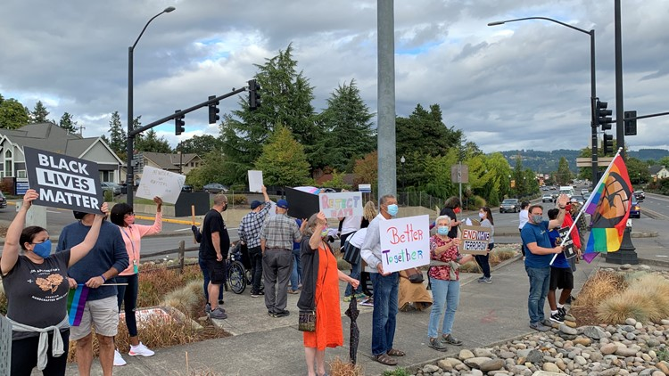 Dozens in Newberg rally against hate amid ban on political signs