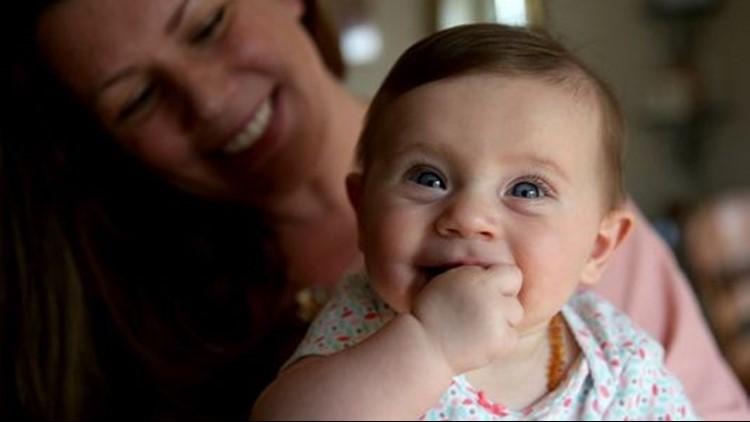 Jennifer Howard, 38, holds her 5-month-old daughter, Evelyn, in thei46d1521c-b42d-458e-a74b-bfd5f5f38dc0-BreastfeedingMom_ar_02_1533865794232.jfif.jpg