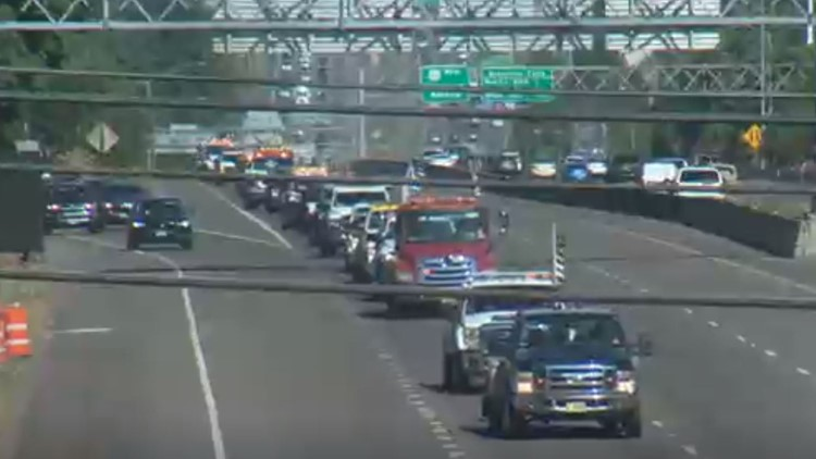Tow truck procession honors driver murdered on the job