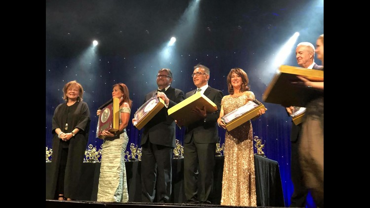 KGW President DJ Wilson, left, and KGW news anchor Laural Porter, second from right, being honored June 9, 2018, at the 55th annual Northwest Emmy Awards in Seattle. KGW
