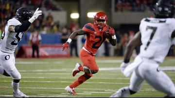 Tate returns, Arizona rolls over No. 19 Oregon 44-15