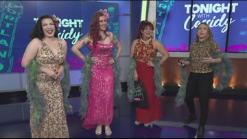Cassidy gets a dance lesson from the ladies of the Oregon Burlesque Festival