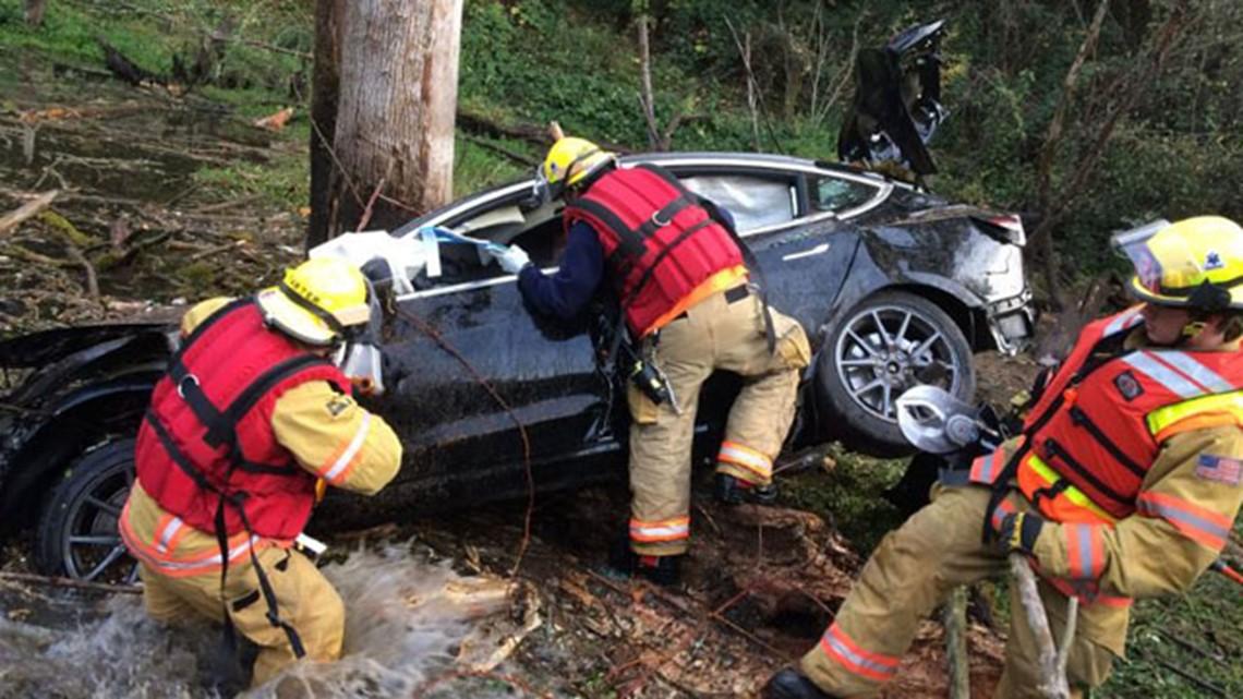 Drunk Tesla driver goes airborne, lands in Clackamas County pond, deputies say