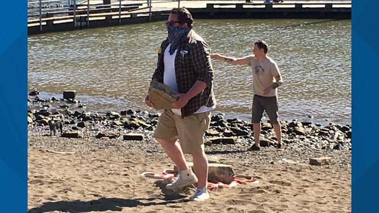 Cathedral Park beach gets a cleanup at low tide from dozens of volunteers
