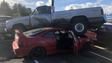 Speeding driver crashes, ends up underneath pickup truck in Newport, police say