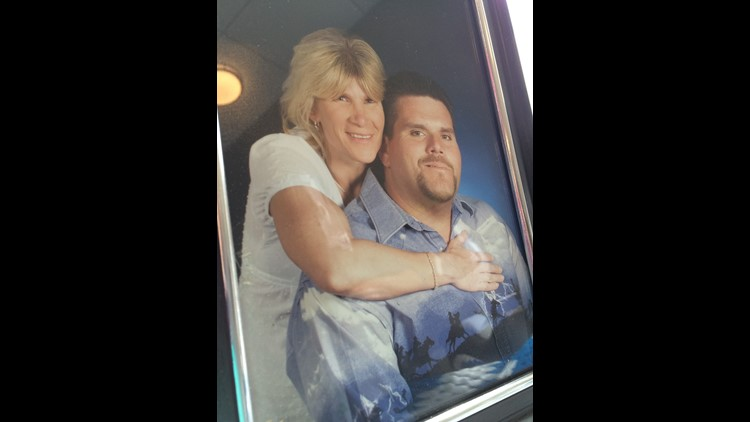 A photo of Crickett and Darren displayed at their wedding