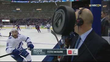 Flying hockey puck barely misses NBC announcer