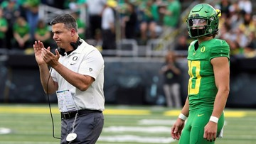Herbert throws 5 TDs and No. 16 Oregon routs Nevada 77-6