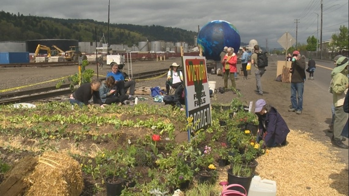Activists plant garden on tracks at Zenith Energy plant in NW Portland