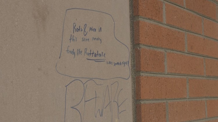 Graffiti outside Dollar Tree warning of mice