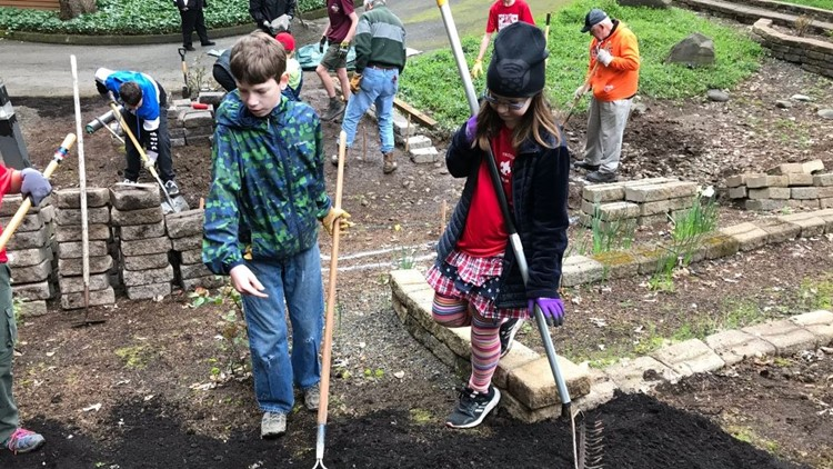 Group of scouts from Tigard build a memorial garden at Tualatin Presbyterian Church