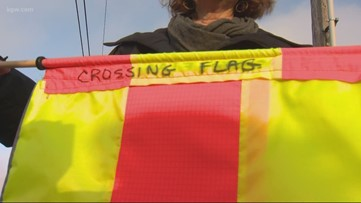 Neighbor hopes homemade crossing flags will make Sandy Boulevard safer