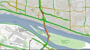 Rolled vehicle blocking 3 lanes of SB I-205 on Glen Jackson Bridge
