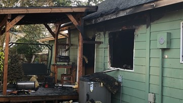 Firefighters rescue dog from burning home in Vancouver