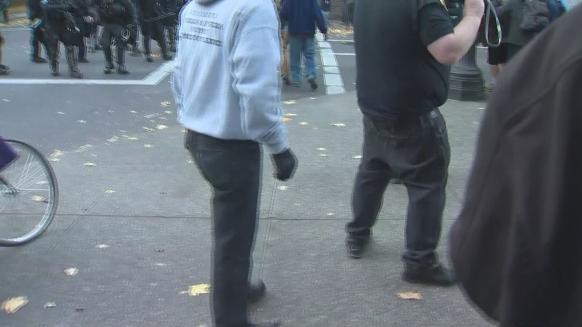 Police throw 'distraction device' during protest clash in Portland