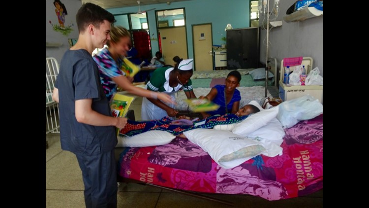 Malcolm with patients in Ghana