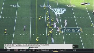 Fan runs onto field, tackled by Oregon Ducks player