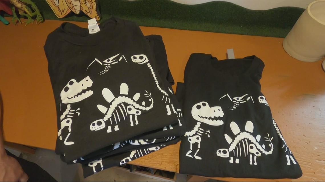 Portland artist creates dinosaur bone T-shirt to help the houseless
