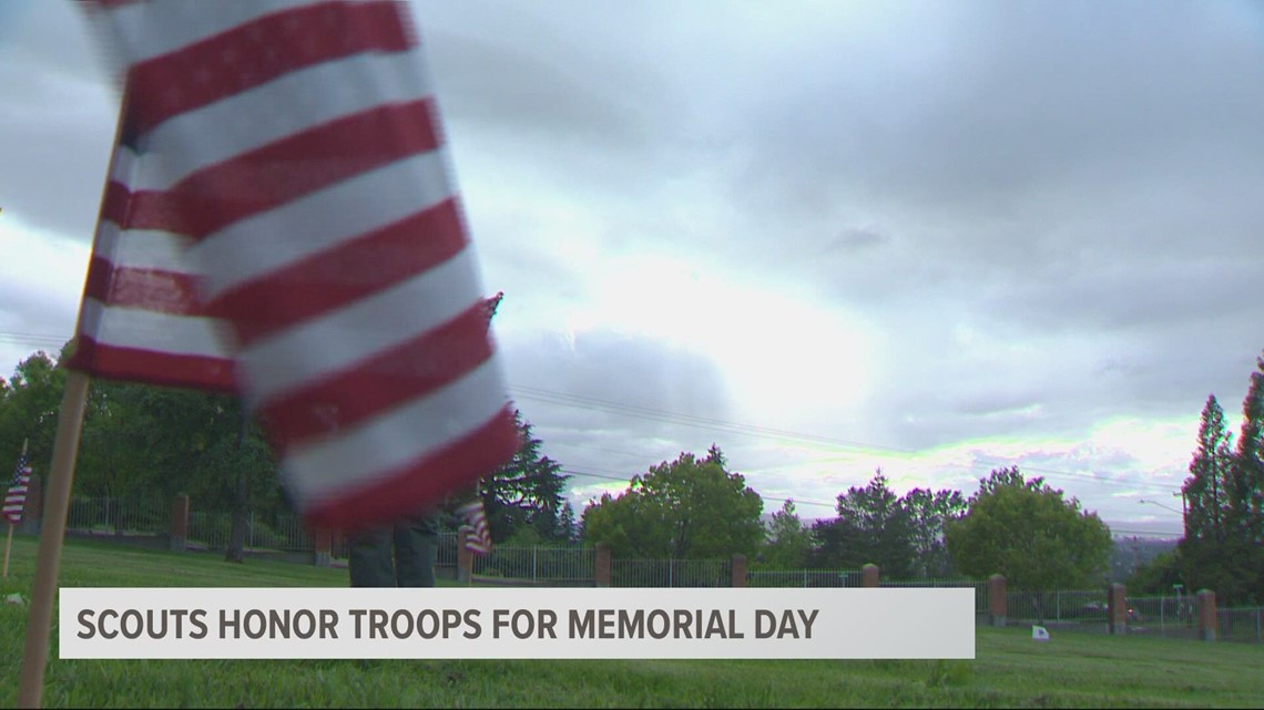 Scouts lay flags on veteran graves for Memorial Day