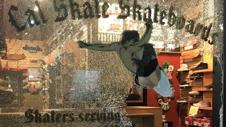 The storefront window at Cal Skate Skateboards smashed-in during a burglary