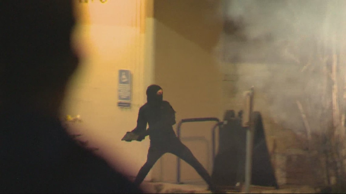 Cleaning up after riot in East Portland
