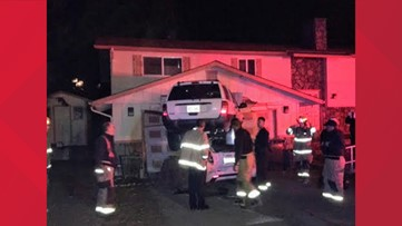 Jeep Cherokee goes airborne, lands on top of car and crashes into house in Washington