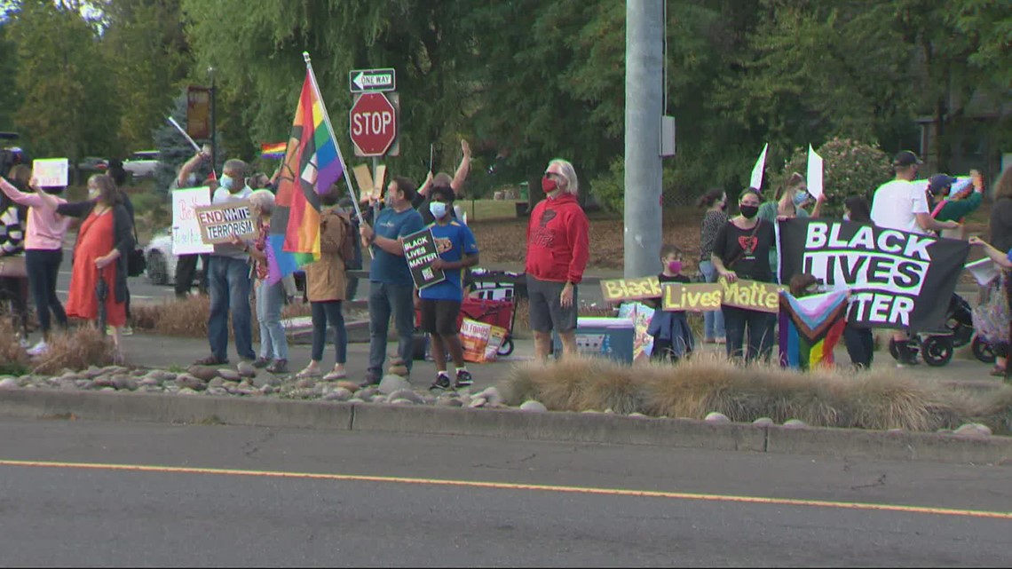Dozens in Newberg rally against hate amid political sign ban
