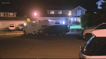 Woman arrested after man's body found in Clark County home
