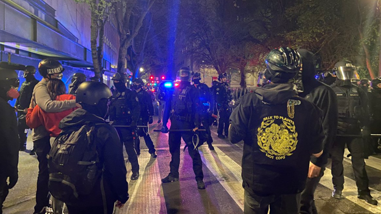 Police declare riot after crowd smashes windows in downtown Portland